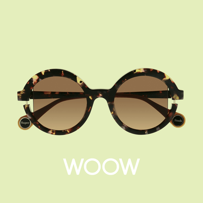 pair of woow sunglasses on lime background