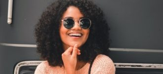 woman wearing sunglasses smiling 640 330x150