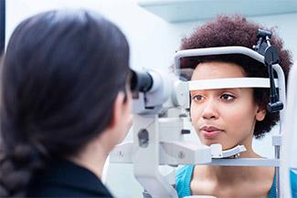 african american woman getting eye exam