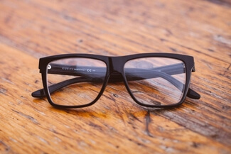 gucci glasses on wood 325×217