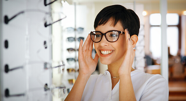 Woman Trying New Eyeglasses