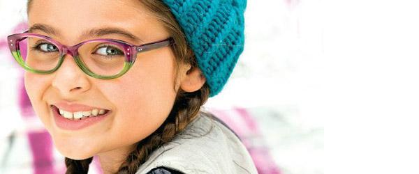 Girl showing off her new eyeglasses