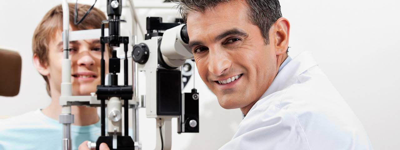 Patient and eye doctor having eye exam