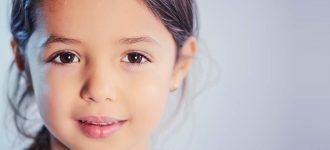 child sparkle brown eyes 330x150 1 330x150
