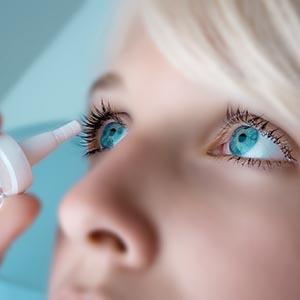 Woman putting eye drops in her eyesin Oak Brook, Illinois