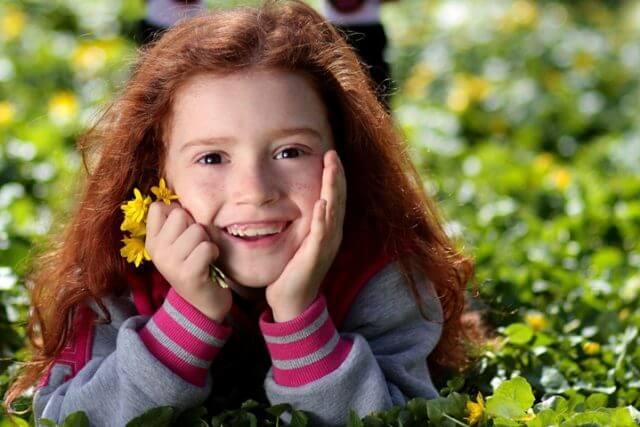 Girl Smiling Grass Flower 1280x480 640x427