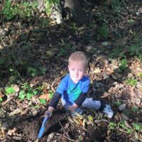 tree planting boy with spade