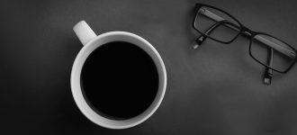 Eyeglasses and coffee
