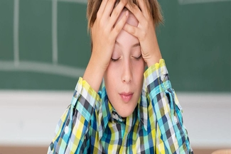 young boy concentrating 325×217