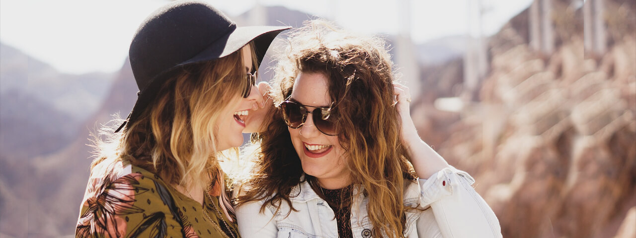 Women Wearing Sunglasses To Protect Themselves Against Harmful UV Radiation at Associates In Eyecare