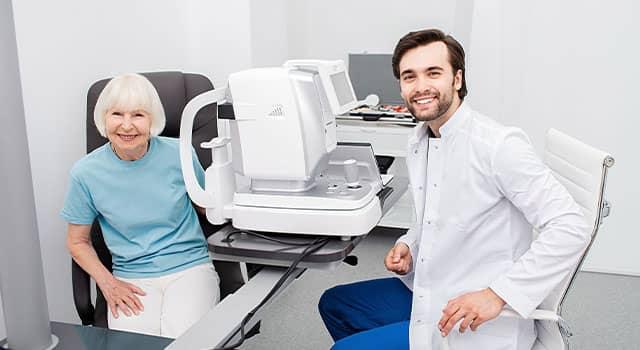 Smiling Optometrist low vision eye exam 640×350 1.jpg