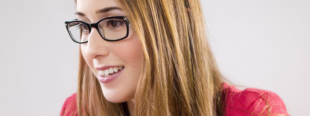 Eye doctor, woman wearing designer eyeglasses in Irvine & Laguna Beach, CA