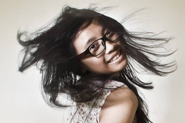 woman with eyeglasses flipping hair at Eastlake Vision Center in Chula Vista, CA