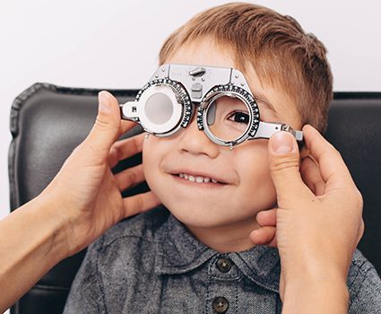 Boy having his eyeglasses prescription checked