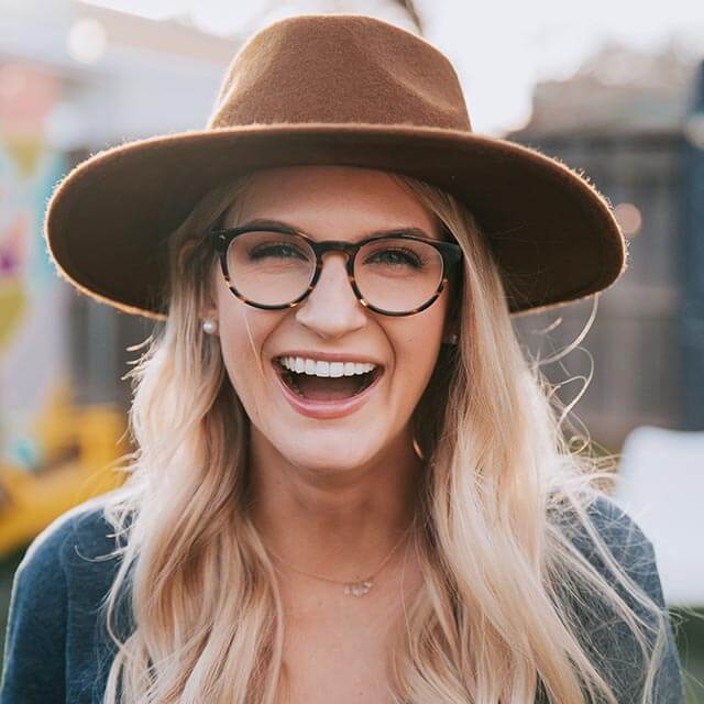 Woman wearing glasses, laughing