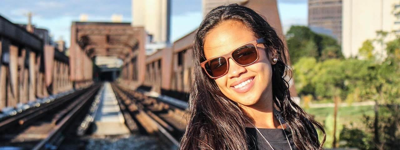 Woman wearing sunglasses against UV Rays