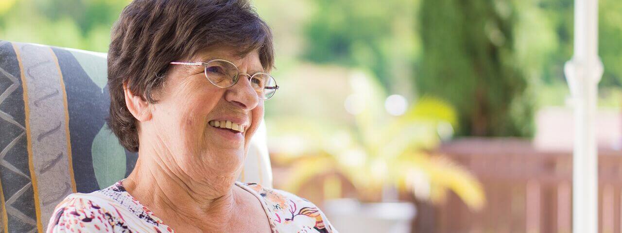 Woman with diabetes, wearing eyeglasses