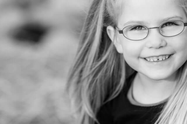 Young Girl Smiling Glasses 1280x480 640x427