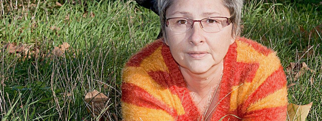 Older woman, wearing eyeglasses