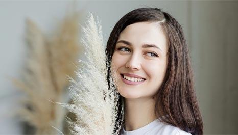 woman with keratoconus, smiling