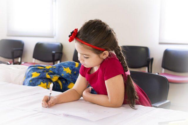Eye doctor, Femal Child Doing School work in St. Charles, Missouri