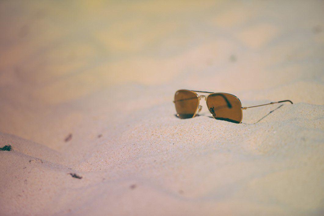 neagtive-space-sunglasses-on-the-beach-Custom-1