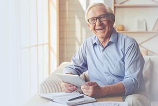 Optometrist, senior man at an eye exam in Bourbonnais, IL