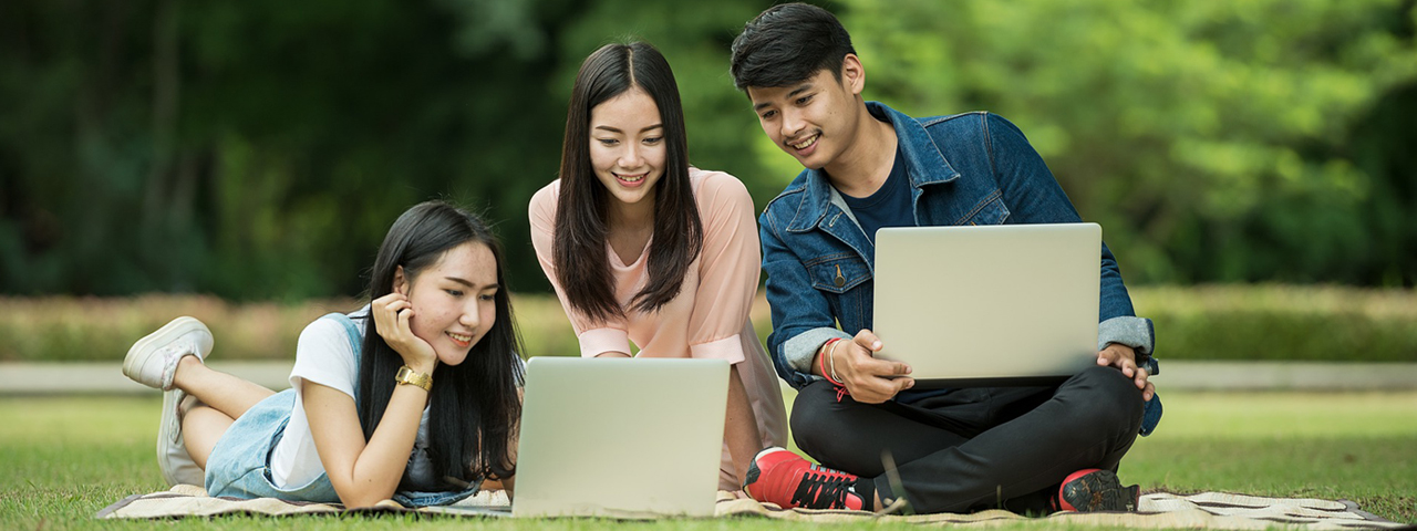 Group of teens with laptops