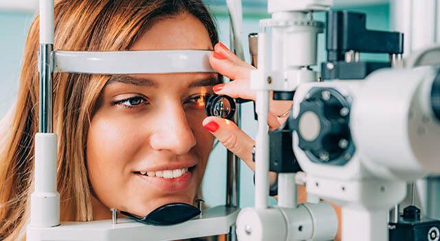 woman having an eye exam in Colorado Springs, CO