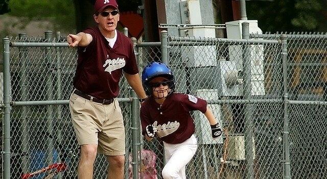 little boy playing baseball 640