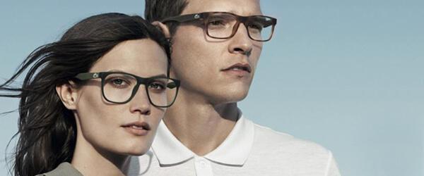 Optometrist, man & woman wearing Lacoste sunglasses in Tupelo, MS