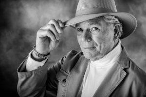 Older Man Hand on Hat 1280x853 300x200