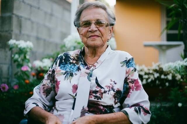 happy senior woman wearing eyeglasses