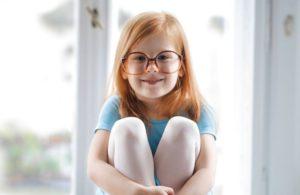 child girl redhead smiling glasses blue ballet dress 1000px.jpg