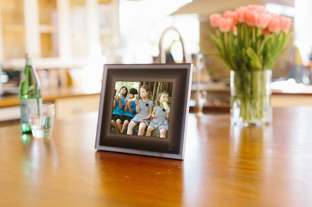 A smart frame that displays the best photos from your phone.