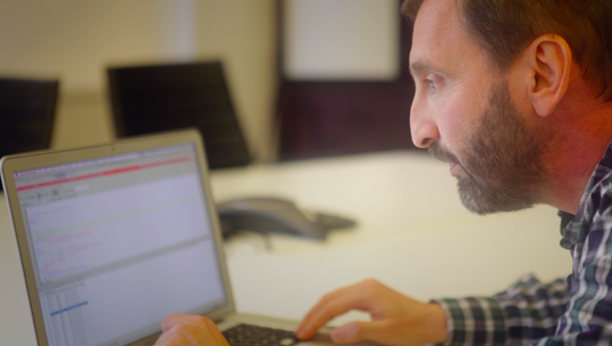 Side profile image of Igor and laptop at Gilt.