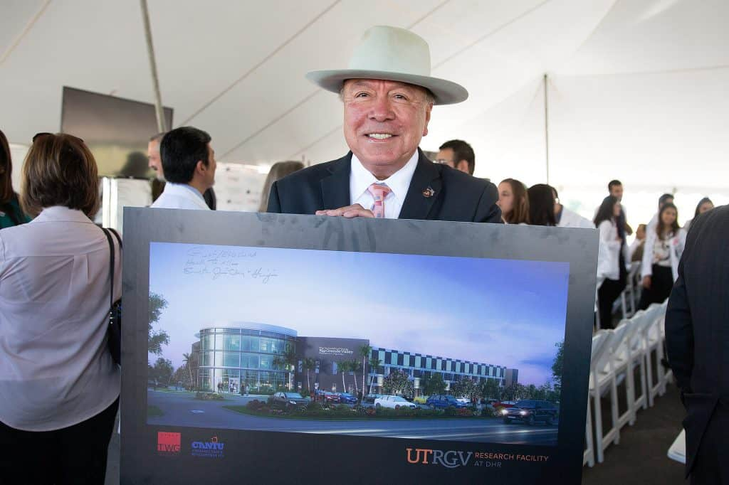 "Juan ""Chuy"" Hinojosa, Texas State Senator, holds up a rendering during the ground breaking for the UTRGV Research Building at DHR on Wednesday, Oct. 26, 2016 in McAllen, Texas. Doctors Hospital at Renaissance is partnering with UTRGV on this new facility. UTRGV Photo by Paul Chouy"