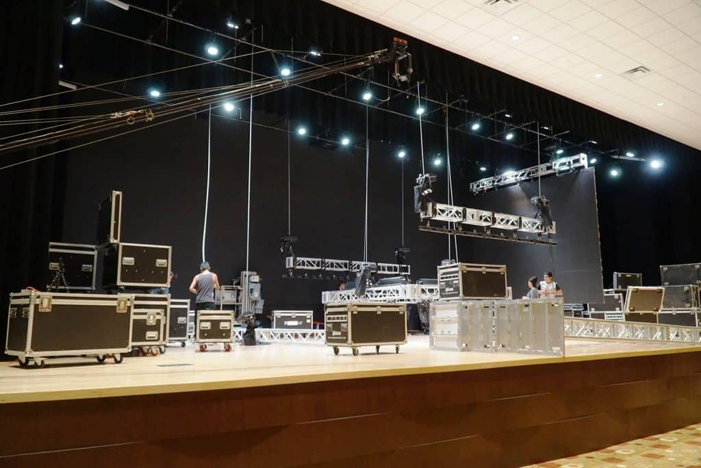 Featured: Technicians on Wednesday, July 9, 2018, set up for a major event to be held on the 3,100 square foot stage of the Edinburg Conference Center at Renaissance Auditorium, which features multiple viewing screens, a state-of-the-art sound system, and theatrical LED lighting. The auditorium is one of the many assets of the 54,000 square foot multi-purpose Edinburg Conference Center at Renaissance, owned by DHR Health, located at 118 Paseo del Prado Avenue in the southwest part of the city. Photograph Courtesy EDINBURG CONFERENCE CENTER AT RENAISSANCE