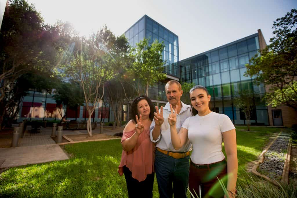 Featured: Raquel Pérez, right, posing with her mother and father, Raquel and Fito Pérez, is the youngest of four children and a migrant farmworker, and she will be the first in her family to graduate from a university when she walks on Saturday, May 11, 2019 at the University of Texas Rio Grande Valley Spring Commencement at the McAllen Convention Center. The journey to get the diploma took five years. She is one of the first at UTRGV to receive the Charles Butt Scholarship for Aspiring Teachers, under the Raise Your Hand Texas Foundation.