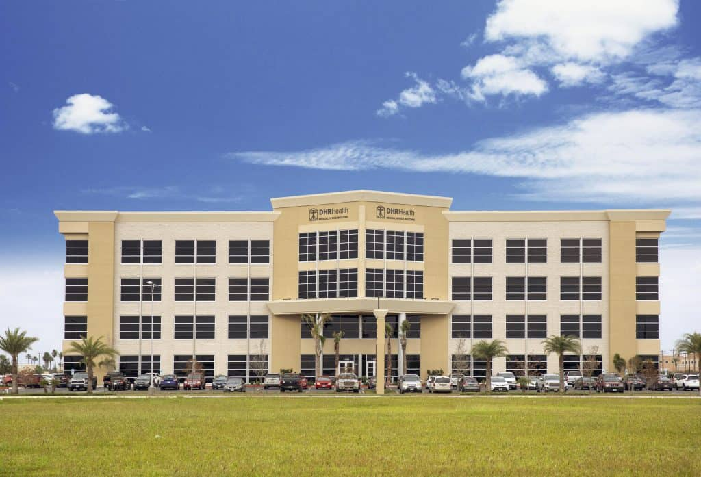 Featured: The DHR Health Medical Office Building at 1100 E. Dove Avenue in northeast McAllen is home to the DHR Health Imaging Center, Women's Imaging Center, Transplant Institute, Surgery Institute, Vein Institute, Ear, Nose and Throat Institute and Plastic & Reconstructive Surgery Institute. The medical complex is one of numerous major facilities located on the 130-acre site, which is headquartered in southwest Edinburg.  Photograph Courtesy R-MYNA EVANS