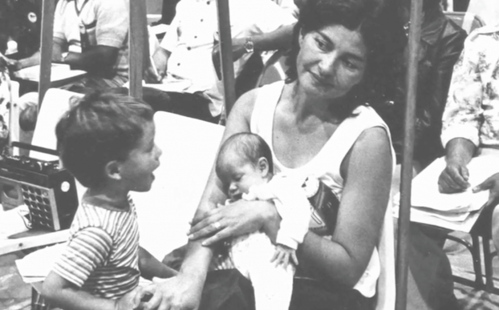 Featured: Rebecca Flores, as a young woman, with two of her three children.