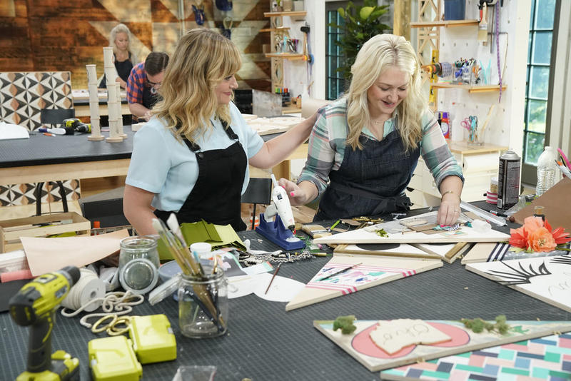 Amy Poehler with contestant Joanna Gick, who owns an interior design firm. Image courtesy of Paul Drinkwater/NBC.