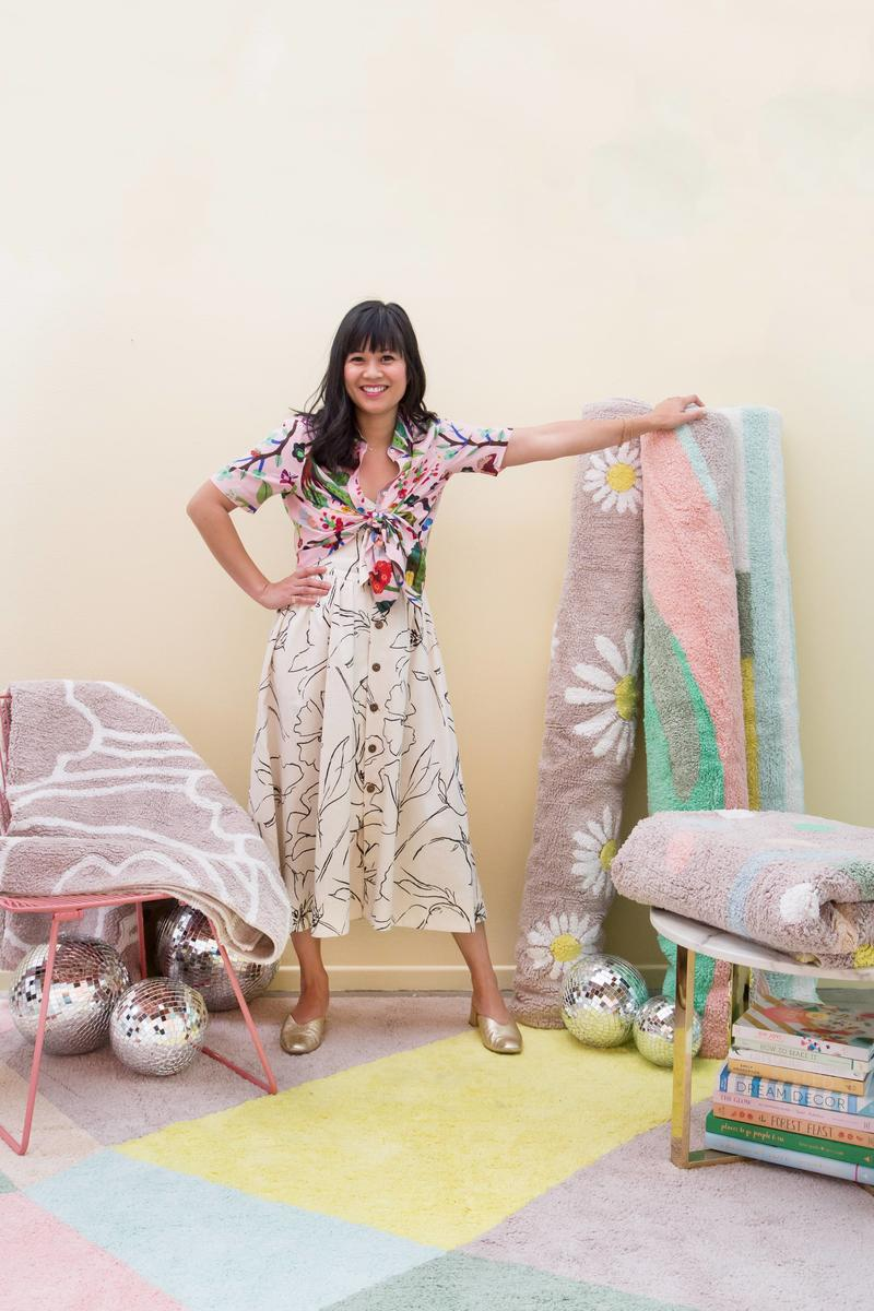 Joy Cho with her Lorena Canals rug collection; courtesy of Lily Glass