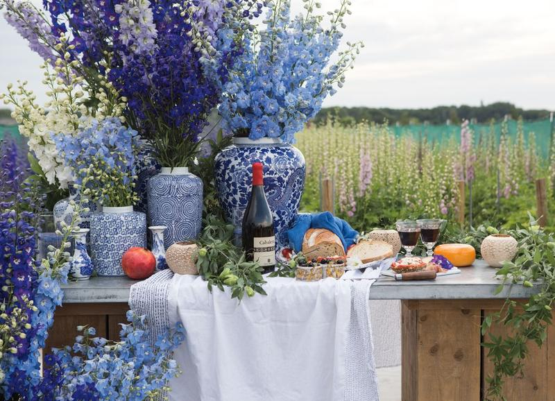 "One of the duo's tablescapes, composed of ""Princess Caroline"" delphiniums at Delphiniumkwekerij farm"