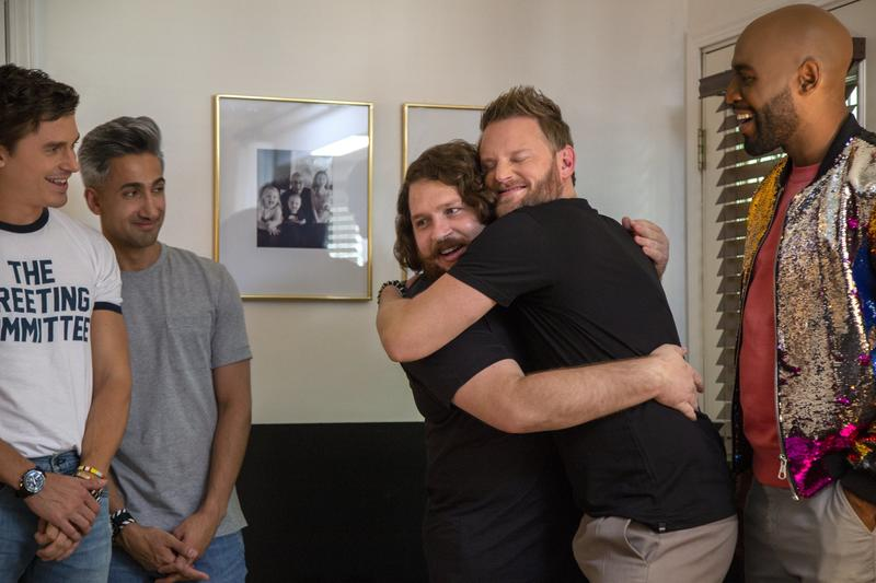 "Bobby Berk hugging a guest on ""Queer Eye"""