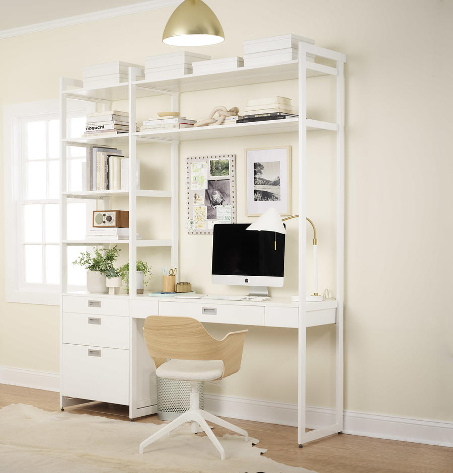 The Everyday System features options beyond the closet, including a desk setup.