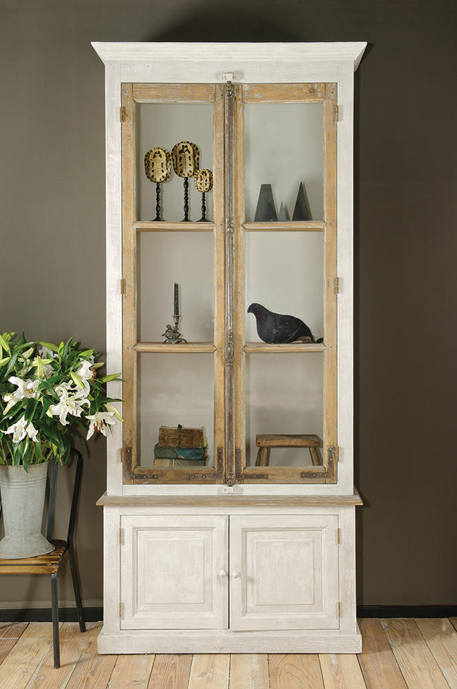 A cabinet from BoBo Intriguing Objects made with reclaimed windows from French chateaus