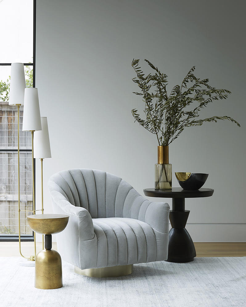 The Elizabeth torchiere, Dax accent table and Springsteen chair from Arteriors