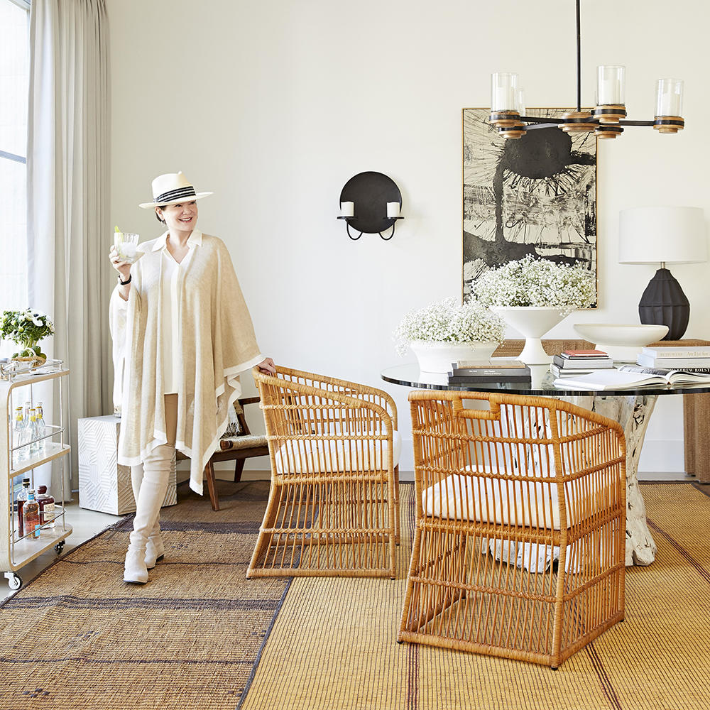 Beth Webb with her Lyford chair from her collection with Arteriors