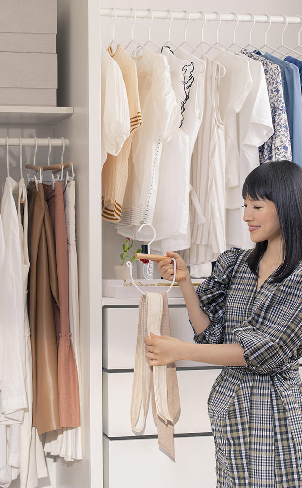 Marie Kondo with an accessories hanger from her line with The Container Store
